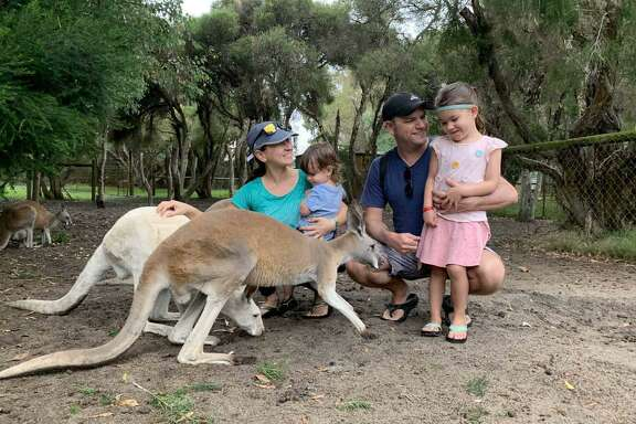 Christi Sparrow, left, her son Camden (in her arms), husband Jay and daughter Chloe pet kangaroos in Western Australia. The San Antonio family was in the middle of a round-the-world trip when the COVID-19 pandemic forced them to stay in Australia for the foreseeable future.