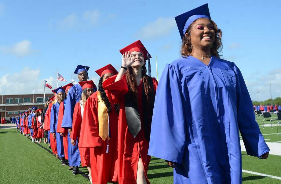 West Brook High School's 2020 graduates enter the stadium as families filled Memorial Stadium Friday morning for the first of its commencement ceremonies. Photo taken Friday, June 5, 2020 Kim Brent/The Enterprise Photo: Kim Brent/The Enterprise