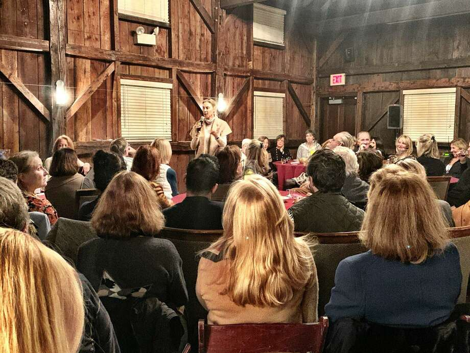 "A photo of a previous event in the Greenwich Historical Society barn with Bonnie Levinson as the emcee. The next biannual ""Story Barn"" event is via Zoom on June 11 with the theme ""Greenwich Together,"" focusing on stories of residents coming together and lending a helping hand at a challenging time for the town. Photo: GHS / Contributed Photo"
