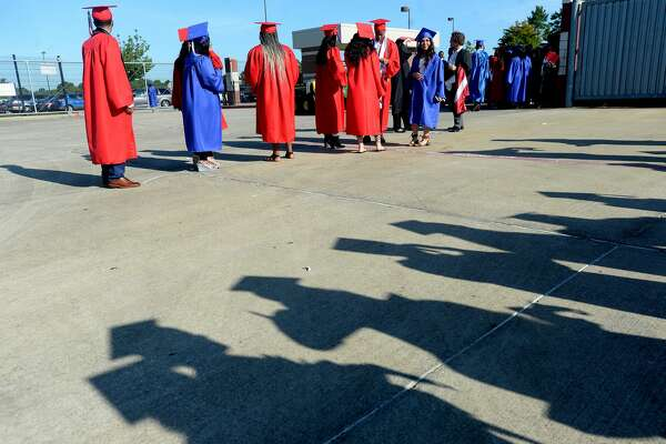West Brook High School's 2020 graduates begin to line up for their commencement ceremony Friday morning. Photo taken Friday, June 5, 2020 Kim Brent/The Enterprise