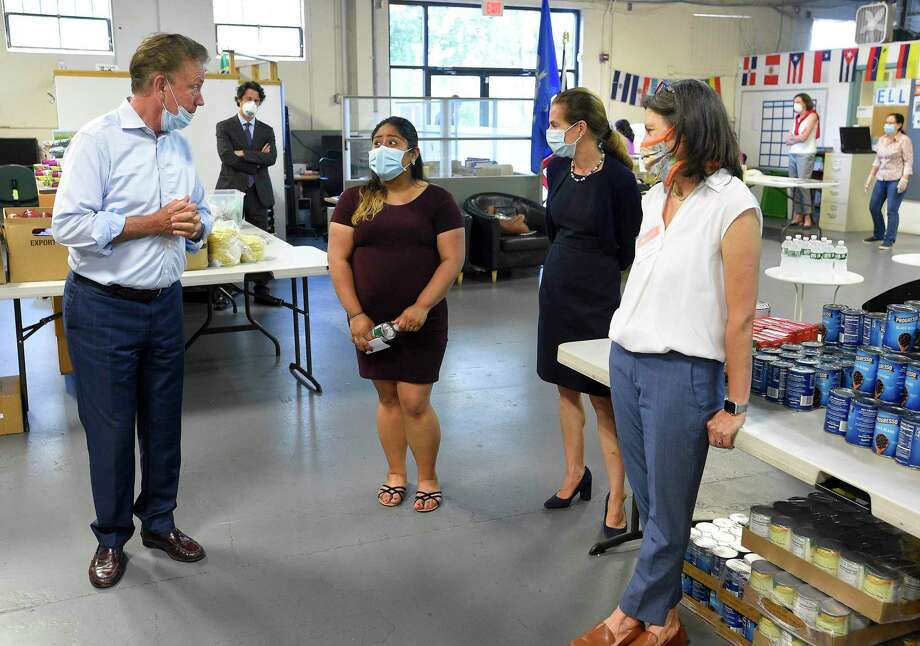 Gov. Ned Lamont and Lt. Gov. Susan Bysiewicz visit Building One Community in Stamford last month. Photo: Matthew Brown / Hearst Connecticut Media / Stamford Advocate