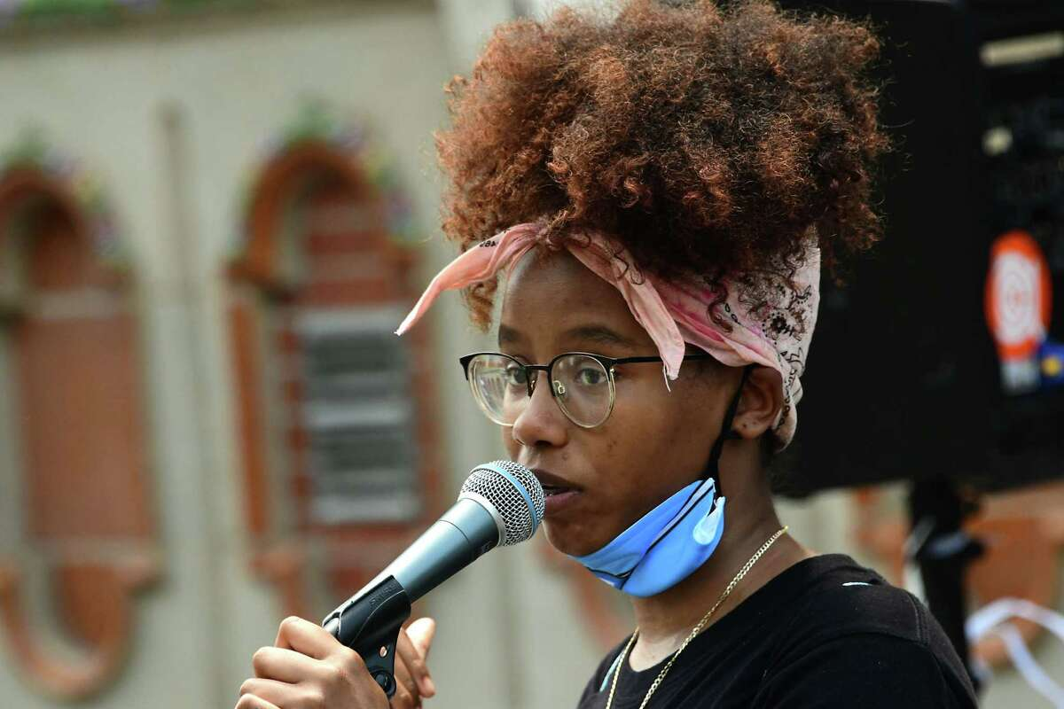 """Alicia Clemente of Albany, shown speaking in June 2020 at a rally against police brutality, is among the Youth FX filmmakers who will be part of a Feb. 19, 2021, virtual panel panel discussion of the new film """"Judas and the Black Messiah."""" (Lori Van Buren/Times Union)"""
