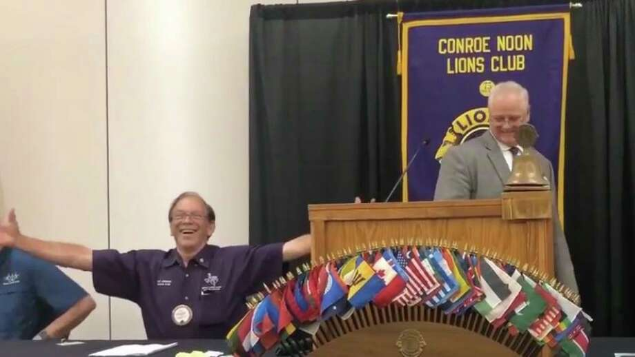 PDG Karl Johnson, left, and plenty of other Lions where giving out 'air hugs' as President Scott Perry, right, welcomed back members to the first 'live' club meeting since the coronavirus break last week at the Lone Star Convention Center. Photo: Courtesy Photo
