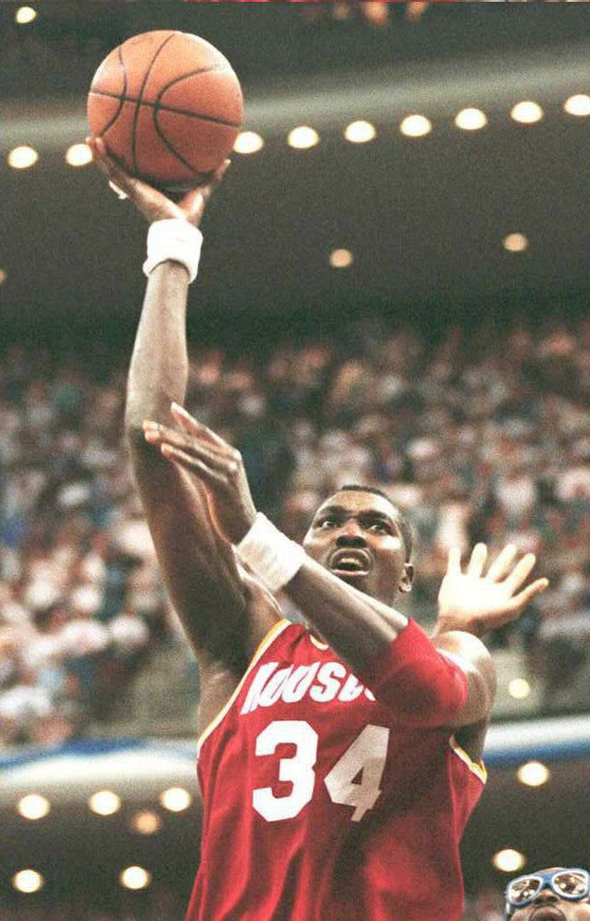 Houston Rockets' Hakeem Olajuwon scores two of his game-high 31 points during overtime of Game 1 of the NBA Finals on June 7, 1995, in Orlando, Fla. The Rockets defeated the Orlando Magic 120-118 in overtime