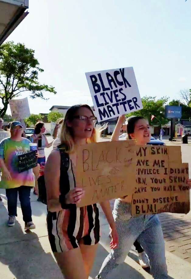 """About 75 protestors marched through downtown Gladwin late Thursday afternoon with signs encouraging unity, justice and shouting """"black lives matter"""" and """"George Floyd."""" Some signs read """"United against racism"""" and """"Injustice anywhere is a threat to justice everywhere."""" (Photo provided)"""