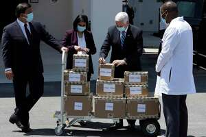 Vice President Mike Pence, second from right, Seema Verma, Administrator of the Centers for Medicare and Medicaid, second from left, and Florida Gov. Ron DeSantis, left, deliver personal protective equipment to a nursing home Wednesday, May 20, 2020, in Orlando, Fla., as part of the initiative to deliver PPE to more than 15,000 nursing homes across America.