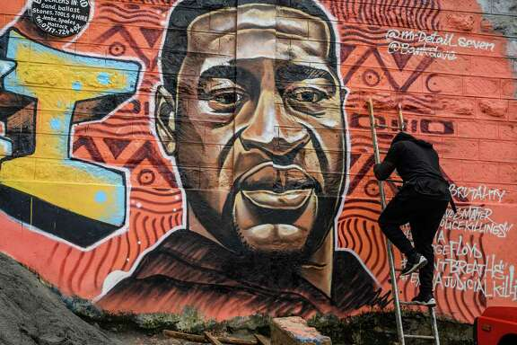 Kenyan mural artist Brian Esendi, also known as Bankslave, paints a graffiti mural in Nairobi depicting George Floyd, whose death has shocked America and the world.  A reader says George Floyd's death should not be reduced or forgotten.