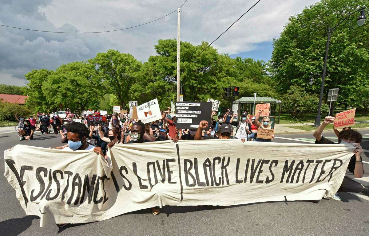 Demonstrators shut down the intersection of Madison Ave. at the entrance to Washington Park for a daily rally against police brutality on Friday, June 5, 2020 in Albany, N.Y. (Lori Van Buren/Times Union)