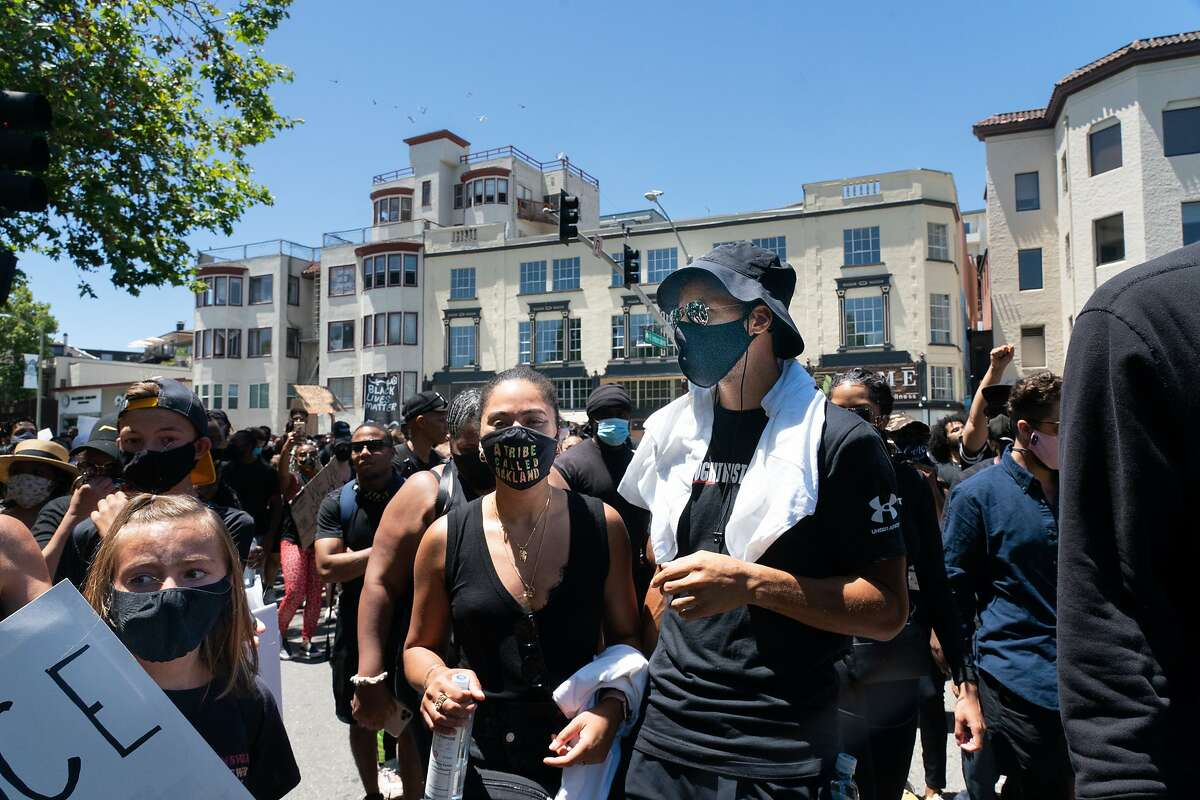 Stephen Curry with wife Ayesha march around Lake Merrit with other Warriors like Klay Thompson, Kevon Looney, and Damion Lee to protest the killing of George Floyd by Minneapolis Police on Wednesday, June 3, 2020 in Oakland, Calif.