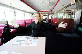 Lushe Gjuarj, owner of Lushe's Parkway Diner, is photographed on May 21, 2020 at her restaurant in Stamford, Connecticut. Gjuarj is hoping that as businesses in the state begin to reopen in Phase 1, that in the next several months with Phase II and III, that she will see a packed restaurant full of customers. She fled Kosovo as a teen during the war, bought and started the diner and during the coronavirus, she has felt the support of customers, who have made donations to help her stay open and set up the diner for outdoor dining. The diner has always provided Take Out service to the community, even in the height of the COVID-19 Pandemic.