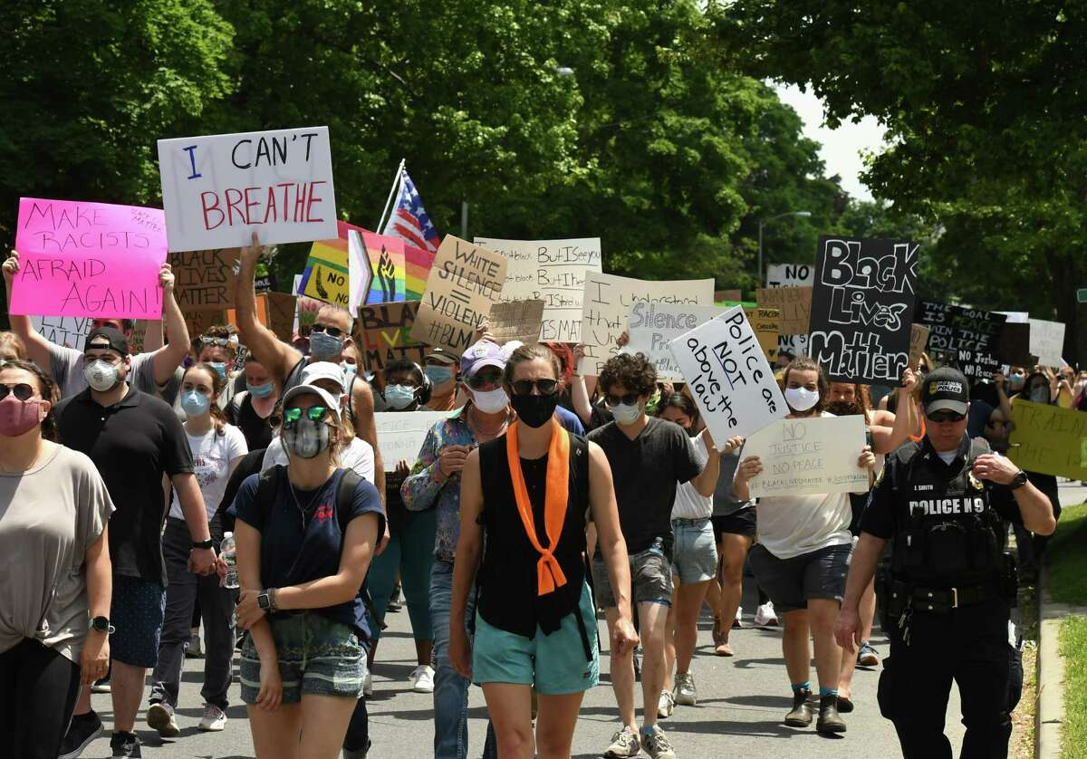 Protesters march down Glen Street during a Black Lives Matter rally on Friday, June 5, 2020, in Glens Falls, N.Y. (Will Waldron/Times Union)