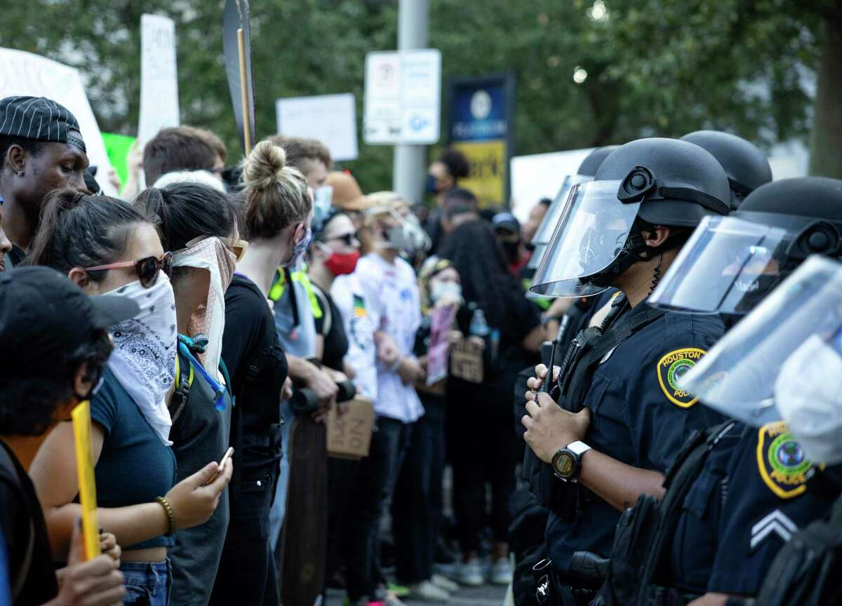 Houston Police deployed helmets and face shields during the massive June 3 downtown protest over the death of George Floyd. City council on Wednesday agreed to buy new helmets and shields.