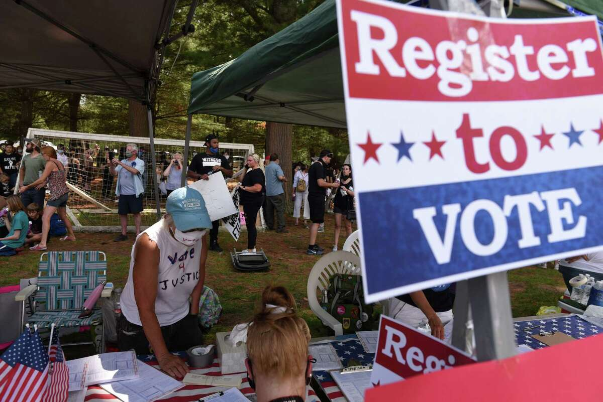 Volunteers assist in helping people register to vote during a Black Lives Matter rally on Friday, June 5, 2020, at Crandall Park in Glens Falls, N.Y. (Will Waldron/Times Union)