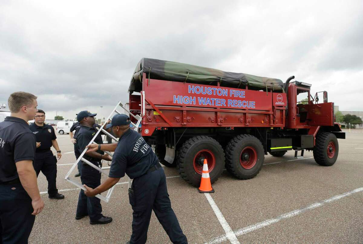 Members of Houston Fire Dept. Station 78 work on training in a high-water vehicle in the parking lot of West Oaks Mall Thursday, Sept. 13, 2018, in Houston. The military grade vehicle will be used as a high water evacuation vehicle.