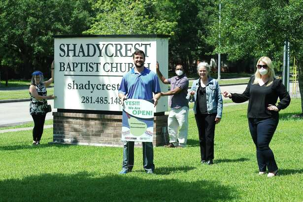 """Marking the placement of a """"Yes We Are Open"""" sign in front of Shadycrest Baptist Church are: Pearland Chamber of Commerce representative Jere Gnader, left, Shadycrest Baptist Church pastor Tyler McKinney, Minuteman Press owner Robin Sookraj, church administrator Janet Kelly and Actioncoach Pearland owner Breanne Salcedo."""