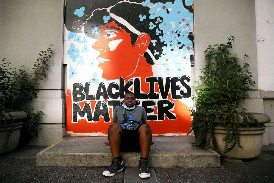 Semaje Williams, 11, of Oakland, poses for a portrait near 14th and Broadway during a protest at Frank Ogawa Plaza in Oakland, Calif., on Thursday, June 4, 2020. Photo: Yalonda M. James / The Chronicle