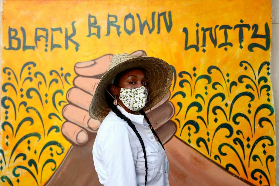 Alysa Wilson, 31, of Oakland, poses for a portrait in front of the Black Brown Unity mural at 14th and Broadway during a George Floyd protest at Frank Ogawa Plaza in Oakland, Calif., on Thursday, June 4, 2020. Floyd, a 46-year-old Black man, was killed by a Minneapolis police officer last week. Photo: Yalonda M. James / The Chronicle