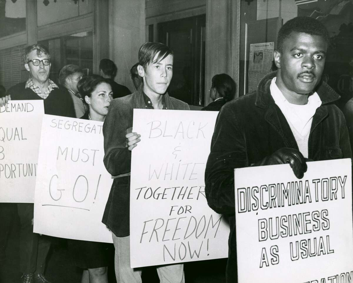 Civil Rights protest at the Oakland Tribune - 1964By the early '60s Oakland was one of the most diverse cities in America, following a mass influx of Black American men from the South in the '40s to help the war effort. By 1960, there were 83,000 African Americans in Oakland, out of a total population of 368,000. As the civil rights movement made its way from southern states to the Bay Area, these new migrants would lead the way in fights for equal rights and fair job opportunities.Alongside UC Berkeley's Black activist groups and local grass roots organizations, the Ad Hoc Committee To End Racial Discrimination was formed in Oakland. On September 4, 1964, the group protested outside the Downtown Oakland Tribune building, demanding an end to its unfair hiring practices.The protests would be unsuccessful in forcing change, and led to a growing frustration amid high unemployment in the community. More explosive forms of Black activism, such as the formation of the Black Panther Party in Oakland, emerged just a few years after the demonstration.