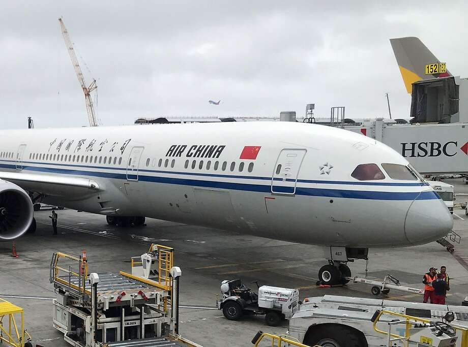 In this file photo taken on May 24, 2018 an Air China airplane sits at a gate at Los Angeles International Airport. - The US modified a ban on Chinese commercial airlines on June 5, 2020, to allow two round-trip flights per week, matching the level permitted by Beijing and de-escalating somewhat a conflict between the countries. (Photo by Daniel SLIM / AFP) (Photo by DANIEL SLIM/AFP via Getty Images) Photo: Daniel Slim, AFP Via Getty Images