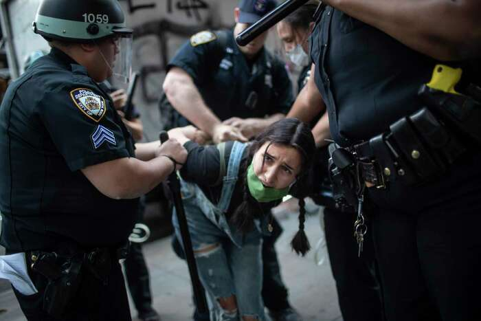 Police detain a protester during a solidarity rally for George Floyd, Saturday, May 30, 2020, in New York. Demonstrators took to the streets of New York City to protest the death of Floyd, a black man who died while in police custody in Minneapolis on May 25. (AP Photo/Wong Maye-E)