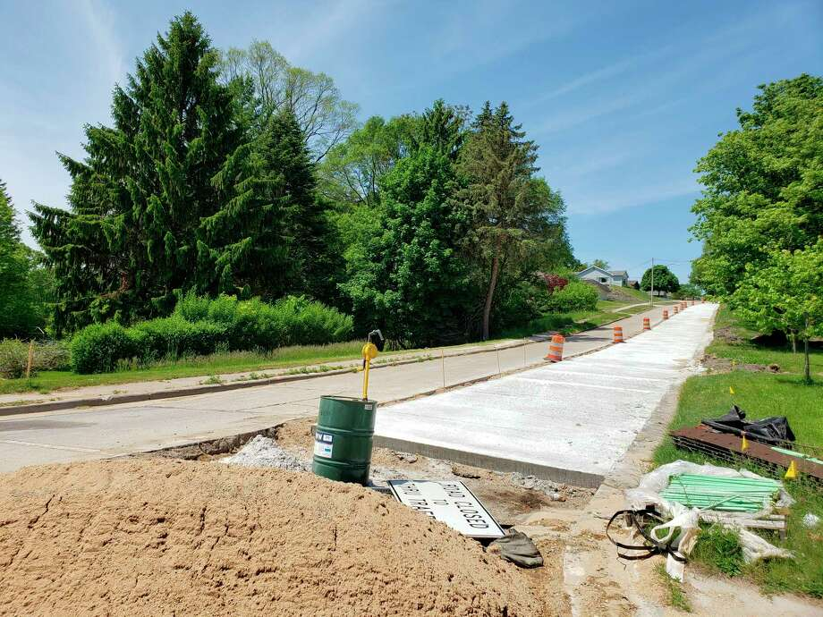 Jeff Mikula, Manistee Public Works director, said the work that spans from the top of Eighth Street hill to Davis Street was meant to pave the way for a project next year, but when work was partway through, the concrete panels started to slide due to their age and the weight. (Arielle Breen/News Advocate)
