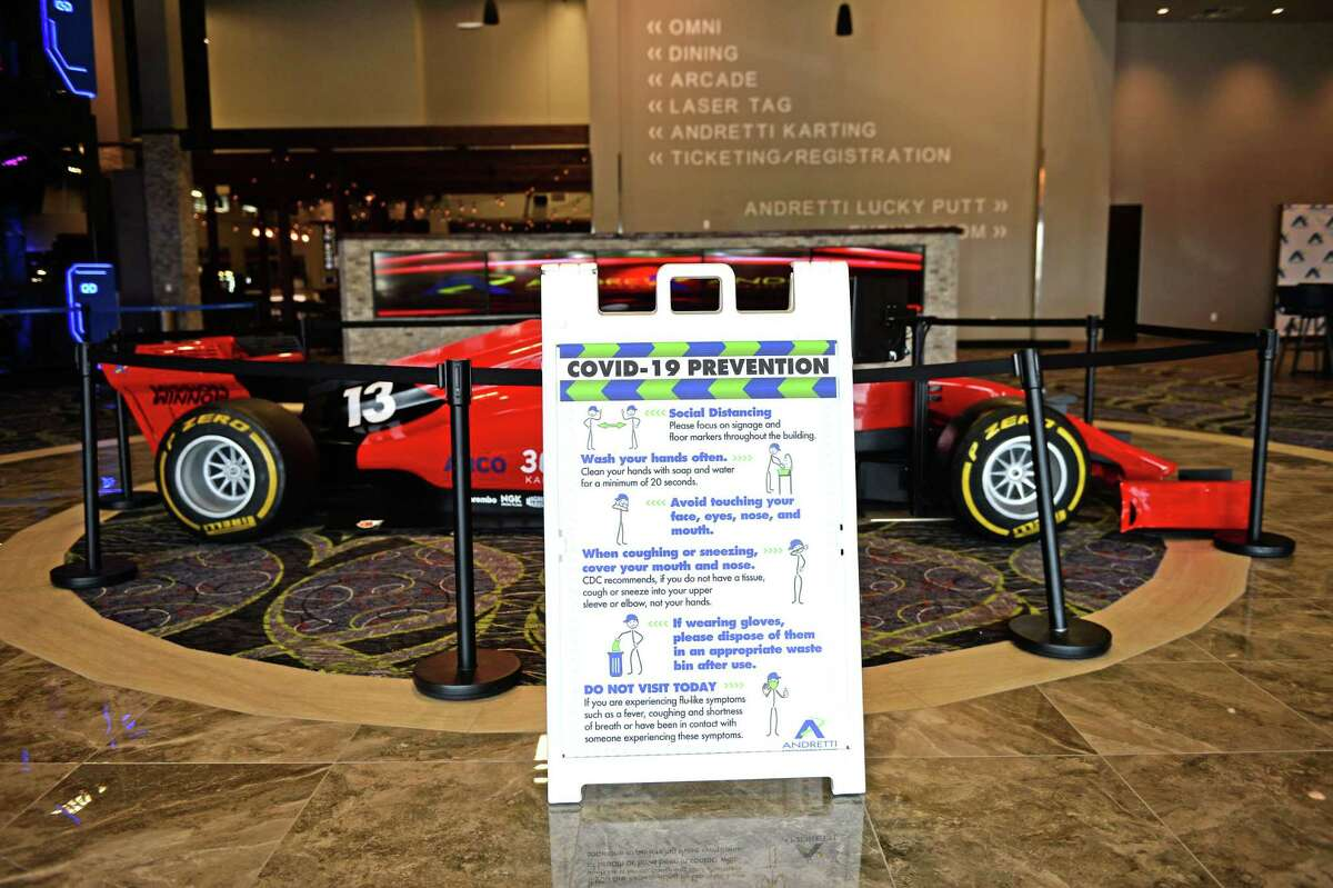 Signage for Covid-19 Prevention is displayed at the entrance to Andretti Indoor Karting & Games, Katy, TX on Thursday, May 28, 2020.