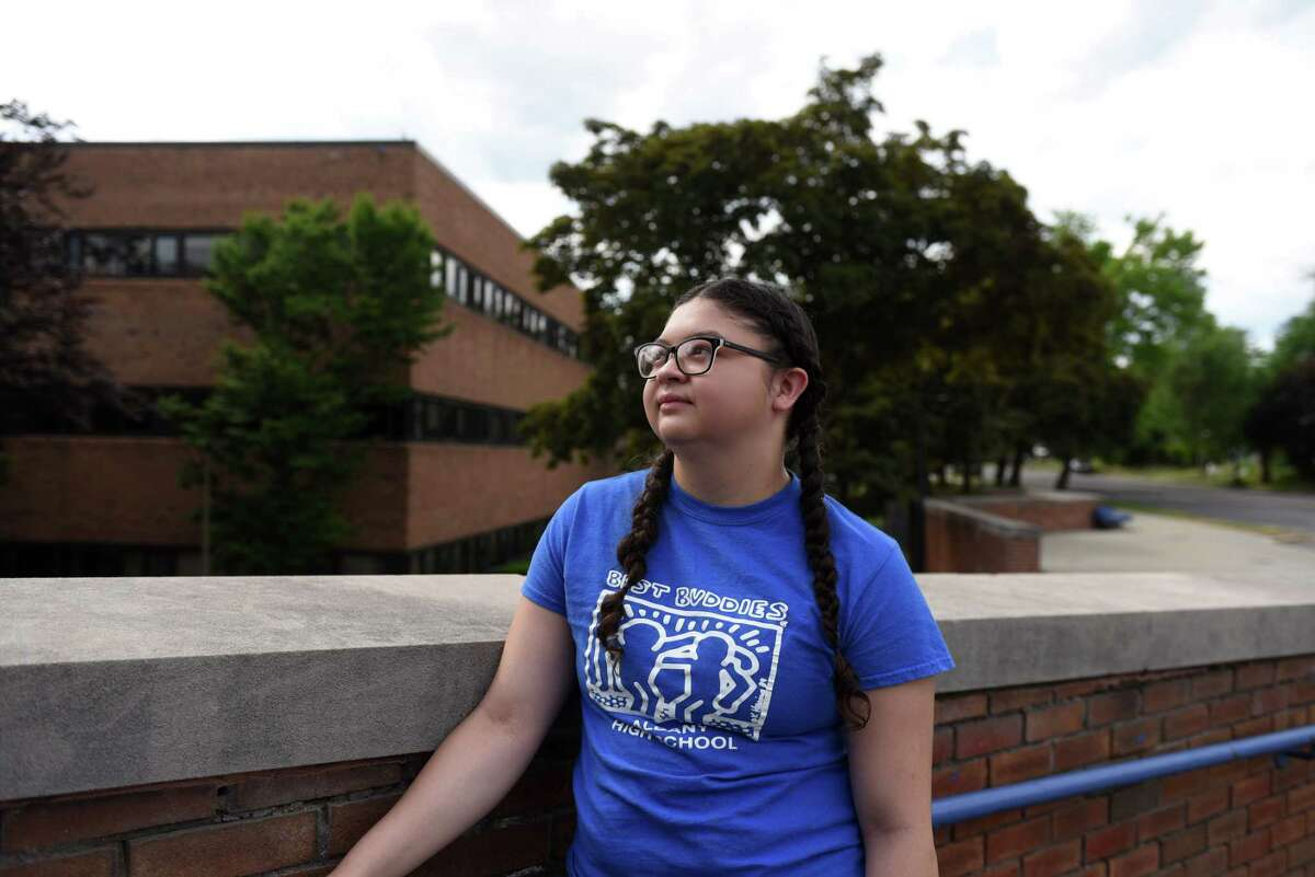 Graduating Albany High School senior Angelina Bolio stands outside her school on Thursday, June 4, 2020, in Albany, N.Y. Bolio is an ROTC cadet who will attend Hudson Valley Community College to train for a career in nursing. (Will Waldron/Times Union)