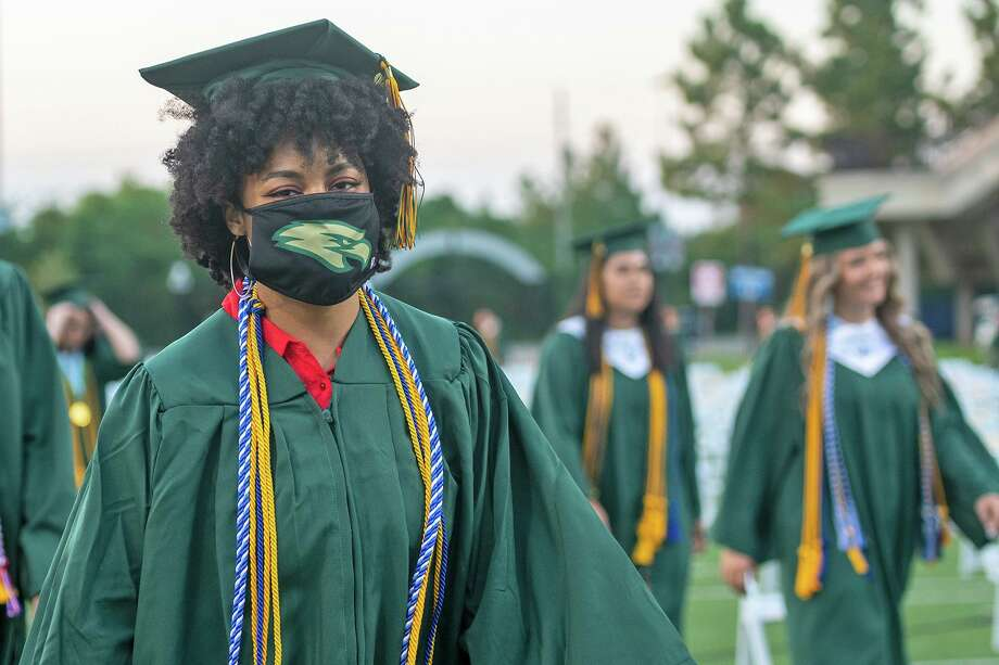 Cypress Falls High School students received their diplomas and graduated while practicing social distancing and wearing masks on June 2, 2020. Students were allowed to remove their masks for photos. Photo: Cy-Fair ISD