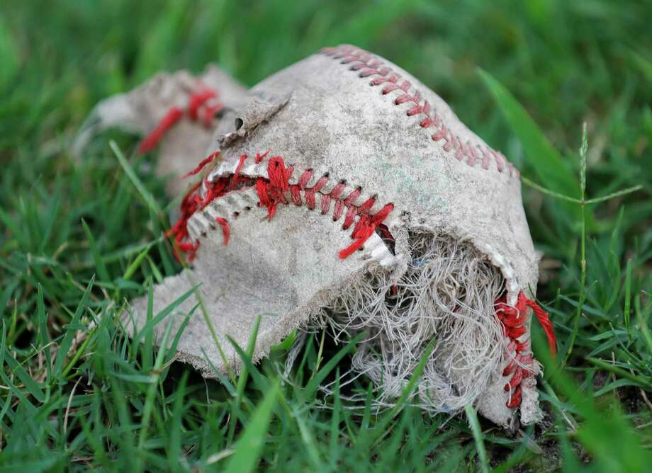 The insides of a baseball is seen on the field leading to the Collerge Park High School baseball field, Thursday, May 21, 2020, in The Woodlands. Photo: Jason Fochtman, Houston Chronicle / Staff Photographer / 2020 © Houston Chronicle