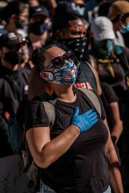 A protester wears gloves and a mask, but not all at the demonstrations did.