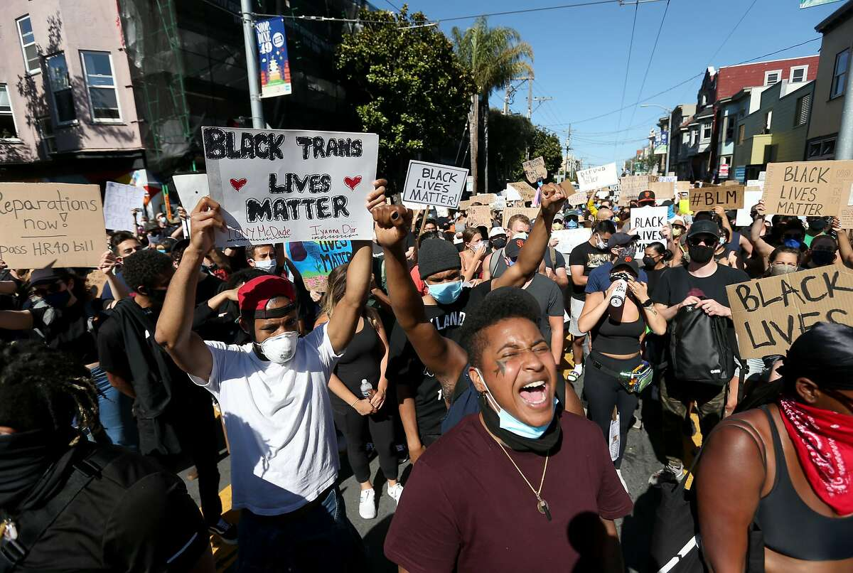 SAN FRANCISCO, CALIFORNIA - JUNE 03: Protesters hold signs and chant during a demonstration to honor of George Floyd on June 03, 2020 in San Francisco, California. Thousands of of people came out to honor George Floyd who died after being held down by Derek Chauvin, a former member of the Minneapolis Police Department who has since been fired and charged with third degree murder. (Photo by Justin Sullivan/Getty Images)