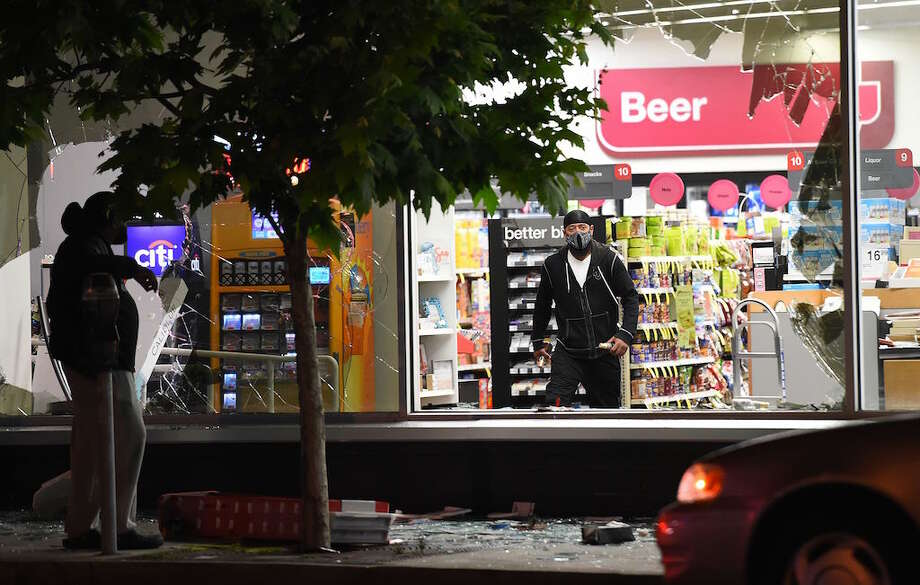 The window of a CVS Pharmacy in Oakland was smashed and the store looted during rioting on May 29, 2020. Protests over the death of George Floyd, a black man who died after a white policeman kneeled on his neck for nine minutes, turned violent in many cities across the nation. Photo: JOSH EDELSON/AFP Via Getty Images