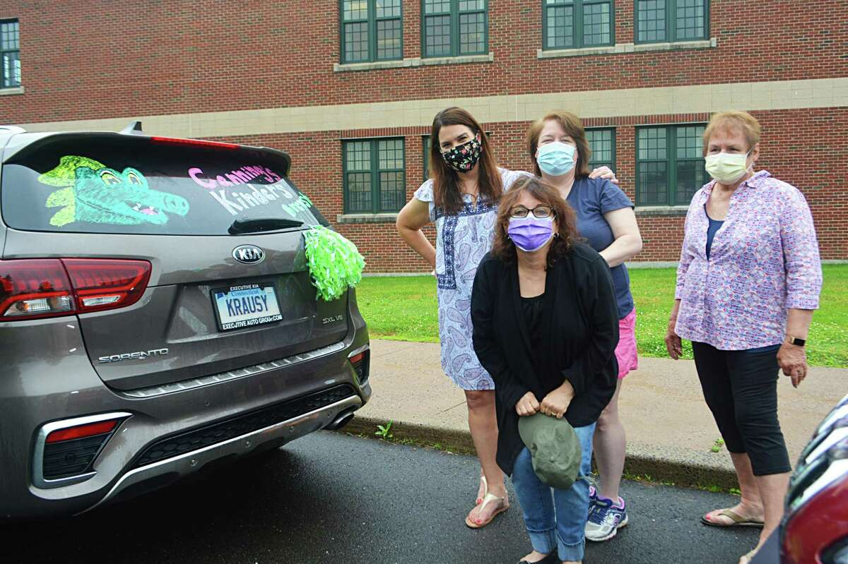 Teachers, administrators and other staff joined together Friday morning at Coginchaug Regional High School in Durham for a giant caravan to mark the end of the academic year in Regional School District 13. From left are Brewster Elementary School kindergarten teacher Jennifer Canning, first-grade teacher Elizabeth Burns, special education therapist Teresa D'Antonio, and paraprofesional Sharon Criscuolo.