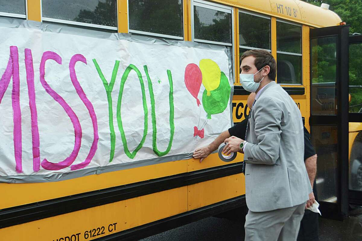 Regional School District 13 staff stepped off from Coginchaug Regional High School in Durham Friday morning for a giant caravan celebrating the end of the academic year.