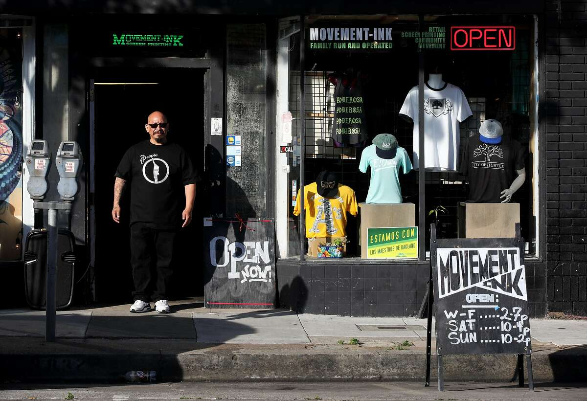RenŽ Qui-onez poses for a portrait at Movement Ink, in Oakland, Calif., on Friday, May 11, 2019. Qui-onez is the owner of the t-shirt print shop in Oakland's Laurel District. He was released from prison 15 years ago and since his release, Qui-onez made it his mission to help his community. In March, Qui-onez stepped back from the business to devote himself to activism and is renting out the shop to other local, POC-owned businesses. He also uses the space to host events for local African American and Latino teenagers to offer them a safe space.