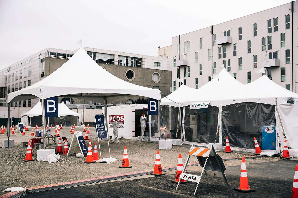 Medical workers are seen at CityTestSF Soma a COVID-19 coronavirus testing site in San Francisco, Calif. on Friday, June 5, 2020.