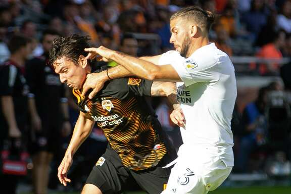 Houston Dynamo defender Zarek Valentin, left, said the MLS will likely return in a World Cup-style tournament.
