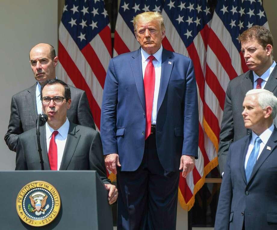 President Donald Trump listens to Treasury Secretary Steven Mnuchin on June 5, 2020, at the White House Rose Garden. Photo: Washington Post Photo By Jonathan Newton / The Washington Post