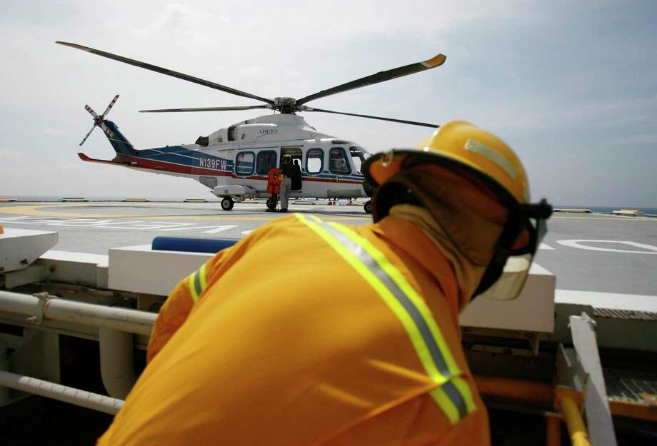 A helicopter lands aboard a Transocean drill ship in the Gulf of Mexico in this August 2007 file photo. Photo: Karen Warren, Staff / Houston Chronicle / Houston Chronicle