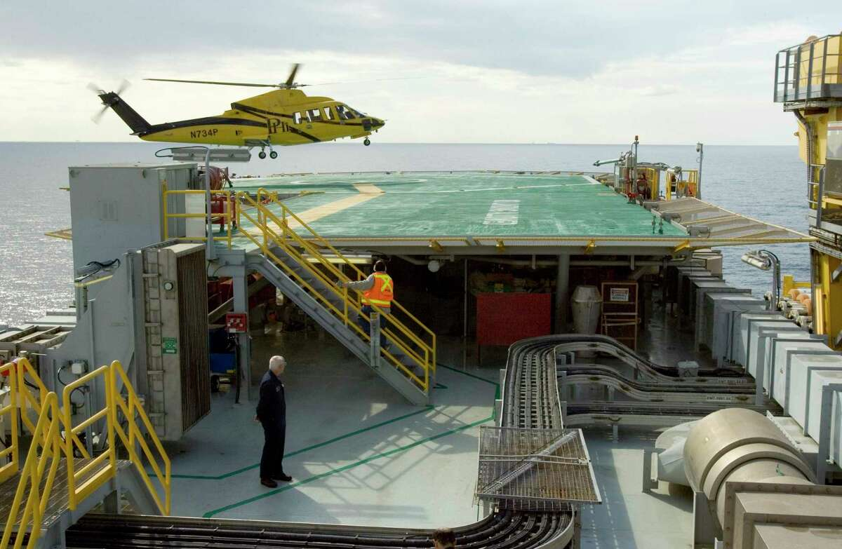 A helicopter lands aboard a BP oil plaform in the Gulf of Mexico in this November 2007 file photo. Oil companies are seeking to minimize the spread of the deadly coronavirus as they evacuate thousands of workers aboard 1,800 offshore production platforms in the Gulf of Mexico as Tropical Depression Cristobal grows in strength and advances toward the Louisiana coast.