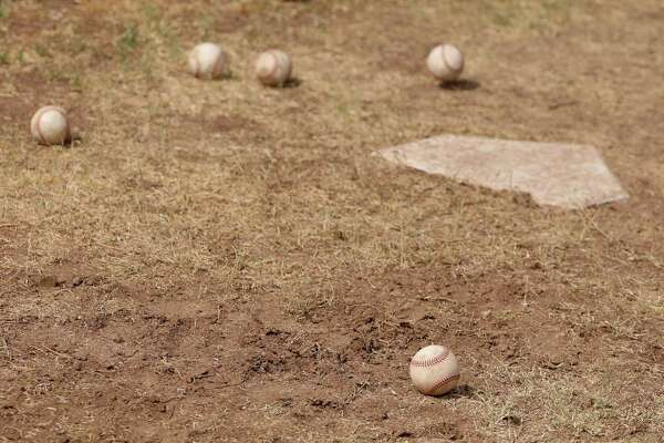 SCOTTSDALE, ARIZONA - JUNE 05: Baseballs are seen on the backyard dirt around a home plate on June 05, 2020 in Scottsdale, Arizona. Since the MLB season was paused indefinitely due to the coronavirus COVID-19 pandemic, players have been using the back yard at Seth Blairs' house to train and work on mechanics. (Photo by Christian Petersen/Getty Images)