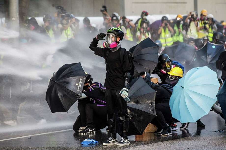 """One year in: What to know about Hong Kong's year of protests One murder might not seem like enough to spark an entire democratic movement, but that's exactly what happened in Hong Kong, a province of China with a high degree of autonomy. A couple from the city took a Valentine's Day trip to Taipei in February 2018. Poon Hiu-wing never returned home, but her 19-year-old boyfriend Chan Tong-kai did. He would soon confess to Hong Kong police that he left a suitcase containing her body near a Taipei subway station after strangling her. He also used Poon's ATM card to withdraw more than $3,000 from her bank account in Taipei and Hong Kong. Hong Kong authorities prosecuted him for money laundering, but they lacked the jurisdiction to charge him with murder. The crime occurred in Taipei, and there was no extradition treaty between Hong Kong and Taiwan. That's when Hong Kong leader Carrie Lam stepped in to fast-track a new bill that would allow the city to send suspected criminals to Taiwan, along with mainland China. Critics slammed the proposed legislation as a threat to the """"one country, two systems"""" arrangement Hong Kong has had with China since 1997. Mass protests against the proposal broke out in March 2019. While the demonstrations initially just called for a withdrawal of the extradition bill, protesters eventually expanded their calls to """"five demands, not one less."""" They wanted the government to reject a characterization of their demonstrations as riots, provide amnesty to arrested activists, allow for an independent investigation of police brutality, and implement universal suffrage. Only one of their needs—withdrawal of the controversial extradition bill—has been met, and activists are continuing to fight for the other four demands to the present day. So what's happened during Hong... Photo: ISAAC LAWRENCE/AFP Via Getty Images"""