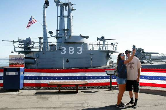 Visitors snap a selfie with the World War II submarine USS Pampanito at Pier 45 in San Francisco, Calif. on Friday, Sept. 13, 2019. The Pampanito rescued 73 prisoners of war left for dead after the Japanese ship they were aboard was torpedoed 75-years ago.