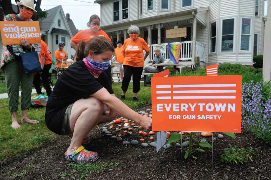 Jennifer Lawlor installed a piece of public art in front of Molten Java in Bethel on Friday afternoon, Gun Violence Awareness Day, in honor of her daughter, Emily Todd, and all other victims and survivors of gun violence. Todd, a 25-year-old Bethel native, was fatally shot in Bridgeport in December 2018. June 6, 2020, in Bethel, Conn. Photo: H John Voorhees III / Hearst Connecticut Media / The News-Times