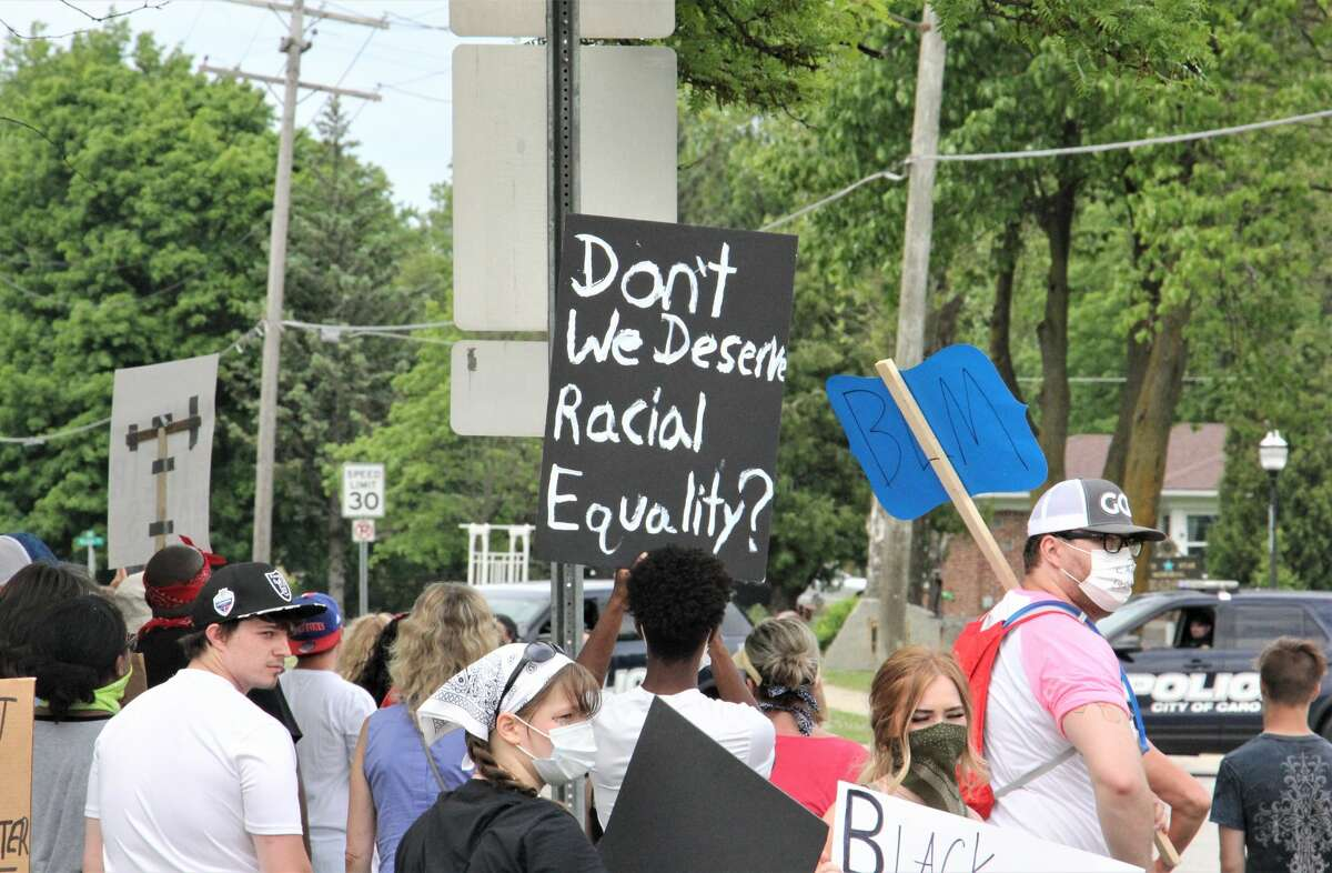 Protestors march through Caro on Friday afternoon, standing against racism and police brutality