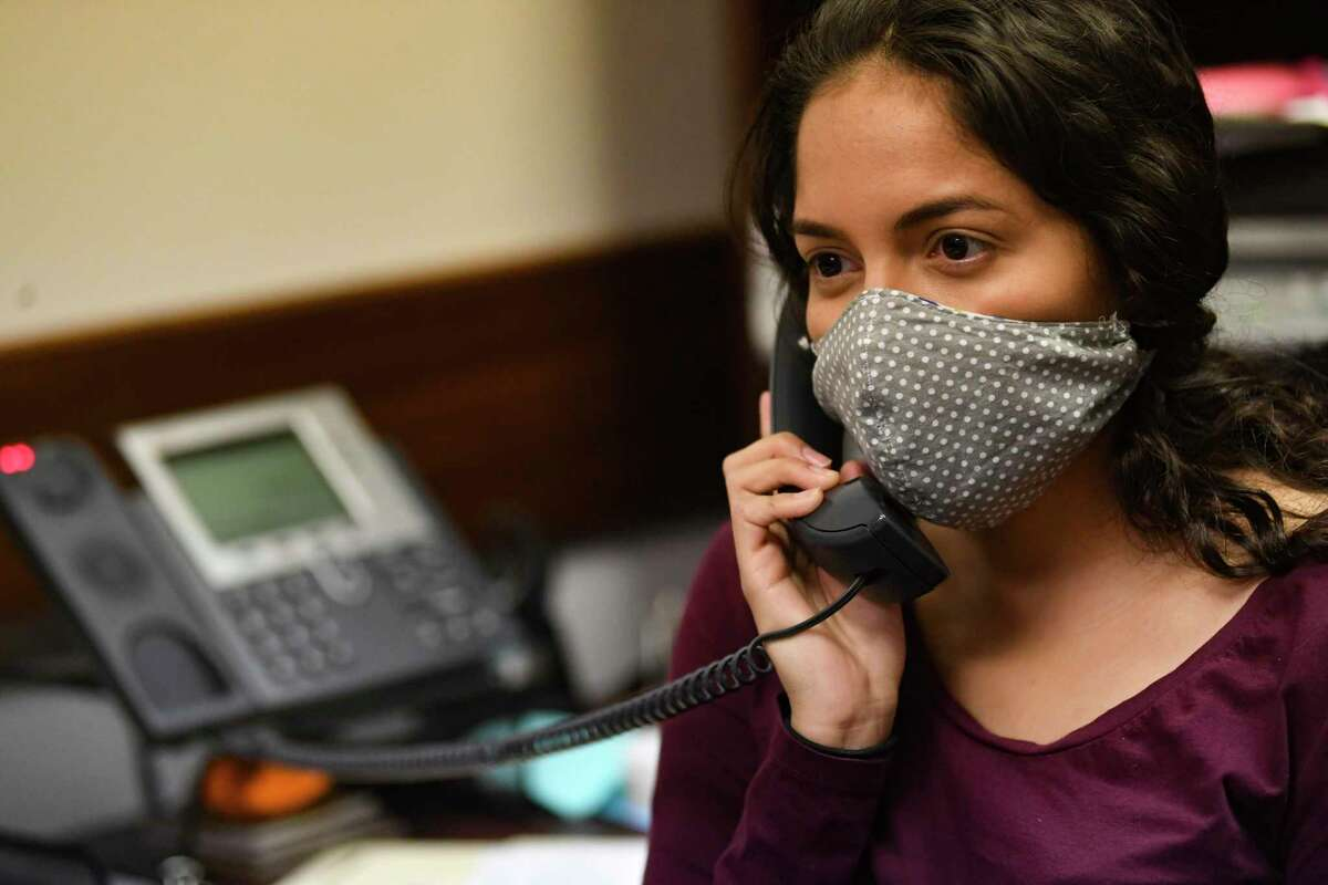 Andrea Valadez, who is almost done with a master's degree in public health from UT Health San Antonio, has been volunteering as a contract tracer for San Antonio Metro Health. She works the phones on Thursday, May 7, 2020.