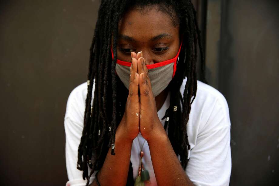 Tiphereth Banks opens her eyes for a moment during a photo shoot near 13th and Broadway in Oakland, Calif., on Friday, June 5, 2020. Banks, an artist and student, is painting a mural a block away. Artists have been creating art to remember George Floyd and other Black people murdered by policer other injustices. Floyd, a 46-year-old Black man, was killed by a Minneapolis police officer last week. Photo: Yalonda M. James / The Chronicle