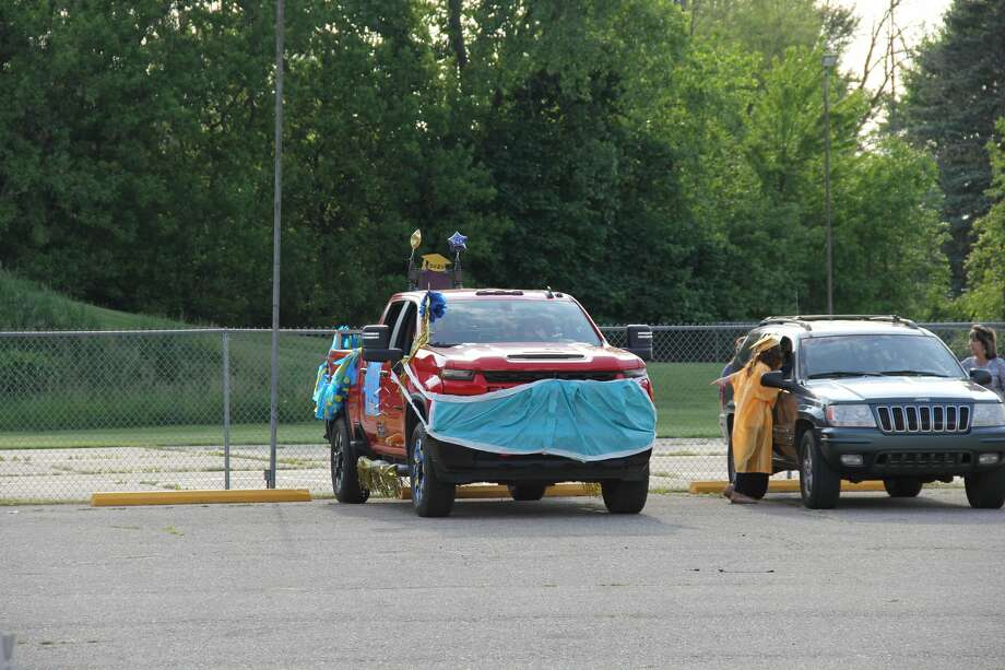North Huron's Class of 2020 celebrated its graduation by having a parade through Kindeon Friday night. It was followed by throwing their caps and posing for photos at the North Huron High School's athletic field. Photo: Robert Creenan Huron Daily Tribune