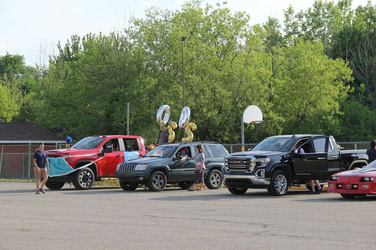 North Huron's Class of 2020 celebrated its graduation by having a parade through Kindeon Friday night. It was followed by throwing their caps and posing for photos at the North Huron High School's athletic field.