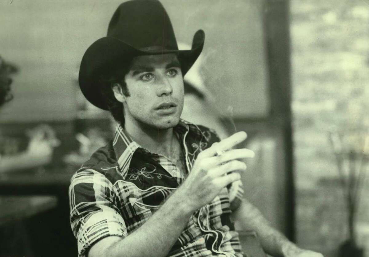 """John Travolta in the 1980 film """"Urban Cowboy,"""" which takes place and was shot in the Houston area."""